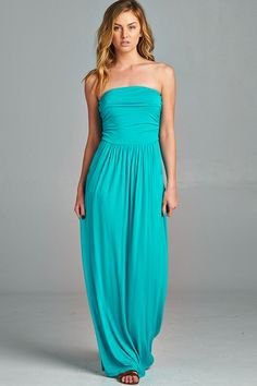 Blue-green fit and a flared maxi dress with open toe heels
