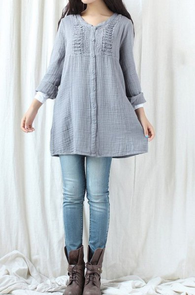 blue-green tunic top made of gathered cotton with light blue jeans