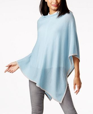 blue-green, semi-transparent cashmere poncho over a white shirt with buttons