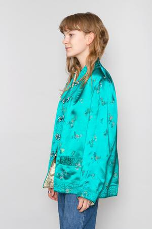 Chinese style silk jacket with blue-green silk and jeans