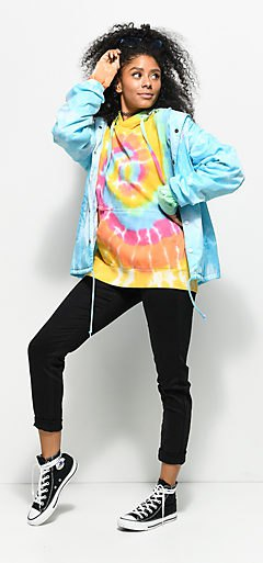 Brightly colored sweatshirt with a light blue windbreaker