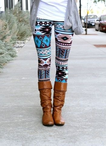 Tribal patterned leggings with brown knee-high boots and a gray cardigan