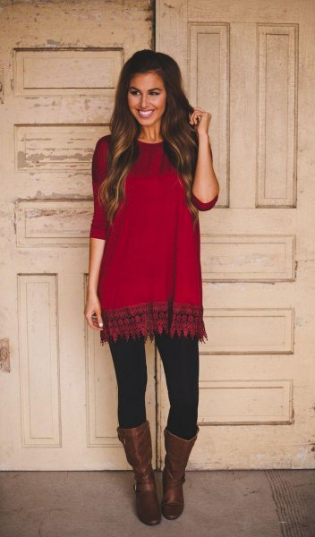red and black tunic with tribal print and leather boots with a medium calf