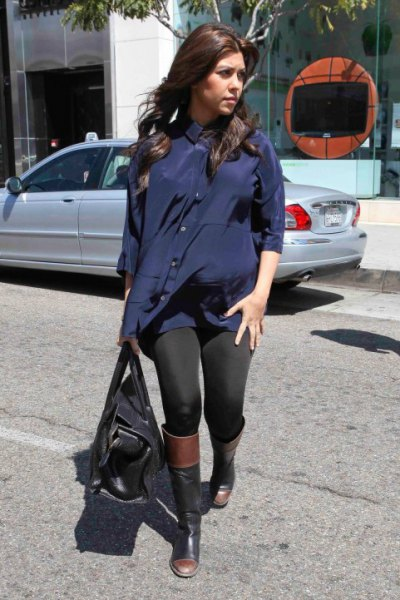 Tunic navy blouse with black leggings and knee-high boots