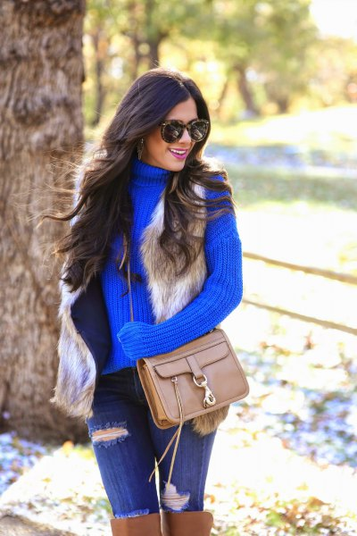 ribbed turtleneck with blue jeans and brown boots above the knee