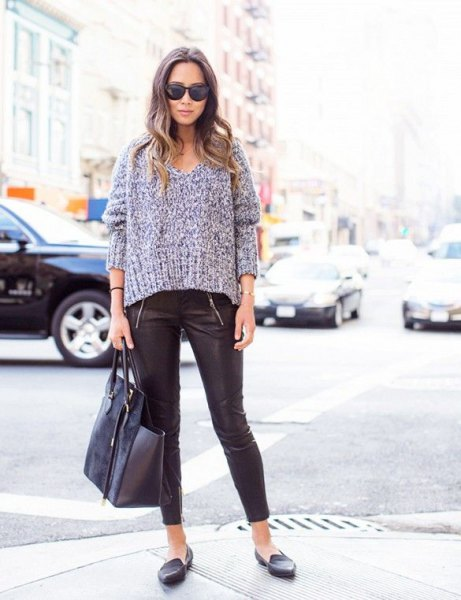 gray, chunky V-neck sweater with leather leggings and slippers