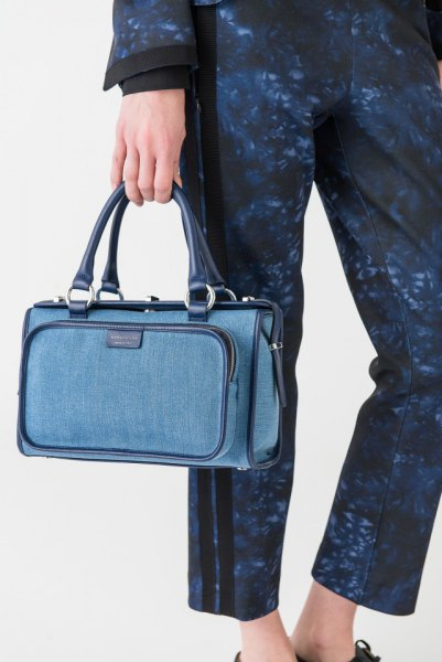 Washed blue long-sleeved coat with matching trousers and jeans handbag