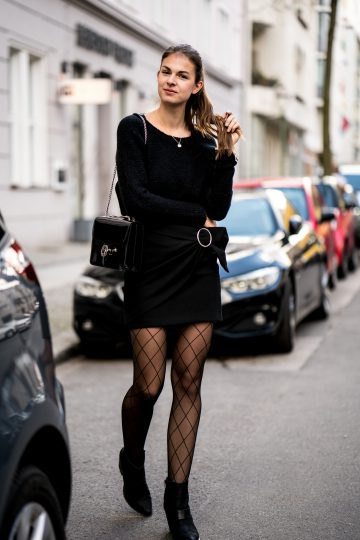 Wear a black skirt with a black knit sweater