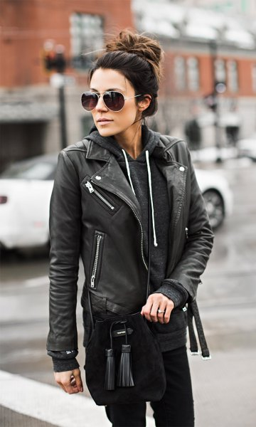 wears a moto leather jacket with hoodie