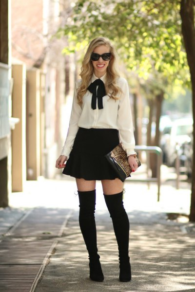 white and black bow tie blouse with skater skirt and overknee boots