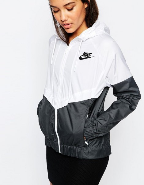 white and black color-block windbreaker with skinny jeans