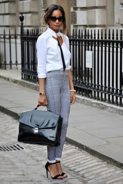 white and black blouse in front with checked chinos