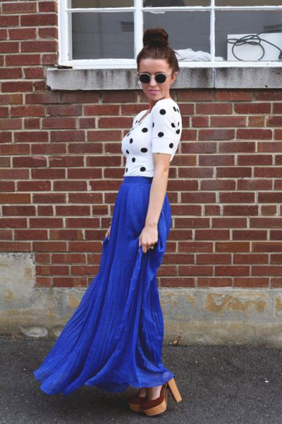 white and black figure-hugging short-sleeved top with blue skirt