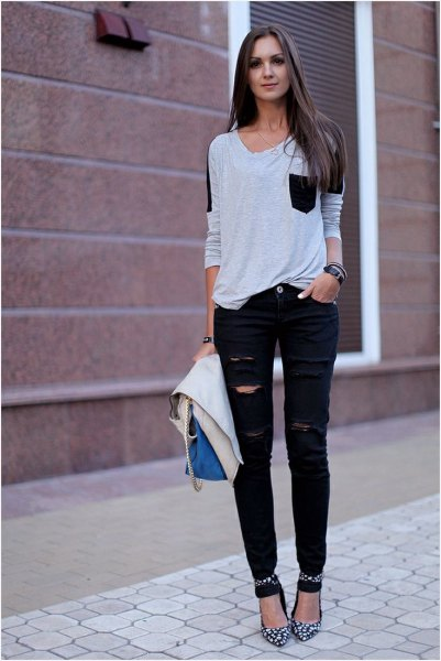 white and black front pocket t-shirt with ripped jeans and ankle strap heels