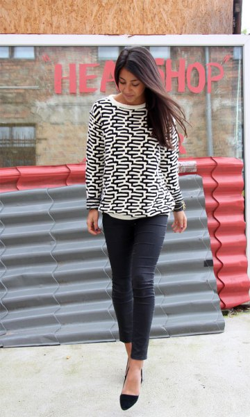 white and black graphic crew neck sweater and black slim fit jeans