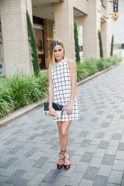 sleeveless mini shift dress with white and black stand-up collar