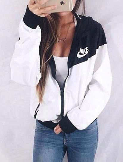 white and black Nike windbreaker with deep tank top and jeans