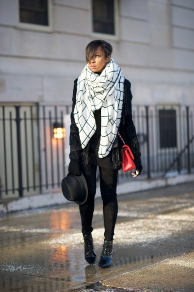 white and black checkered blanket scarf with leather jacket