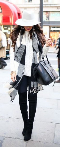 white and black checked scarf with floppy hat and skinny jeans