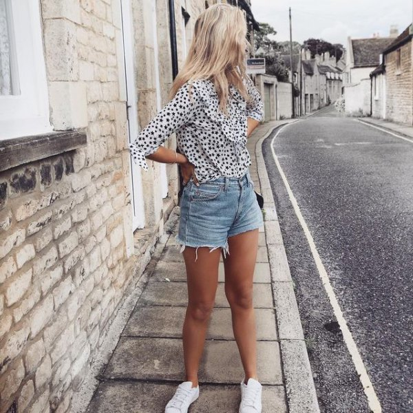 white and black polka dot chiffon blouse with blue high waist shorts