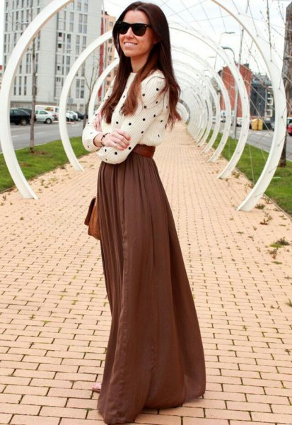 white and black polka dot top with green long flowing skirt