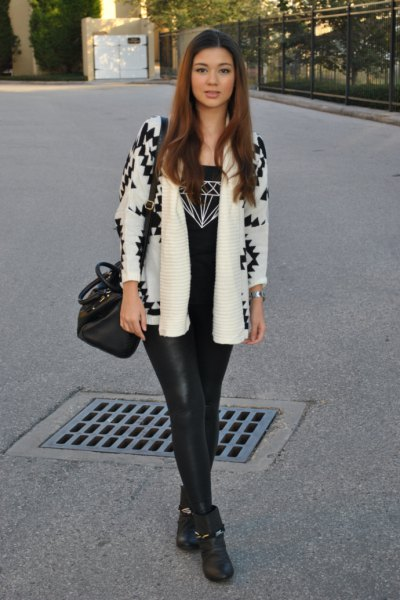 white and black printed blazer with leather gaiters