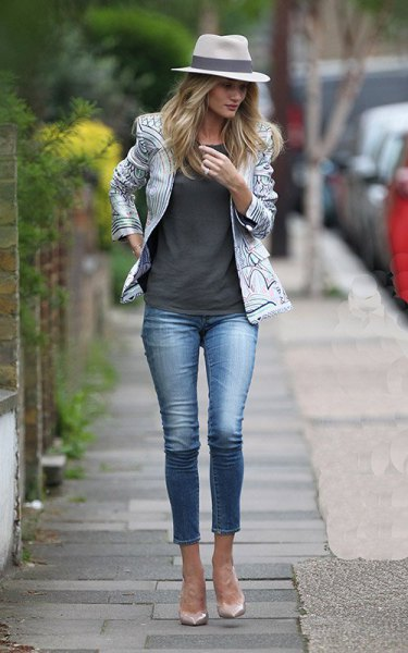 white and black printed leather jacket with gray tank top and short jeans