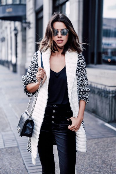 white and black printed longline cardigan with velvet trousers