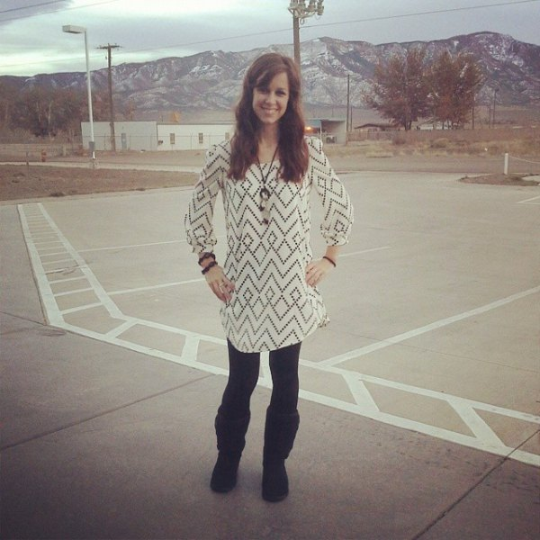white and black printed tunic blouse with black, fleece-lined leggings and boots