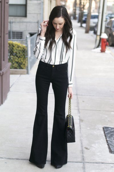 white and black striped shirt with buttons and flared trousers