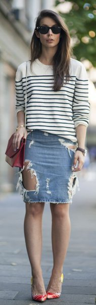 white and black striped knitted sweater with a round neckline and light blue denim mini skirt