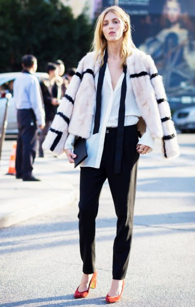 white and black striped faux fur coat with black chinos and orange heels