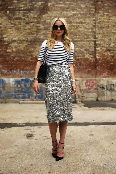 white and black striped knitted sweater with gold midi sequin skirt