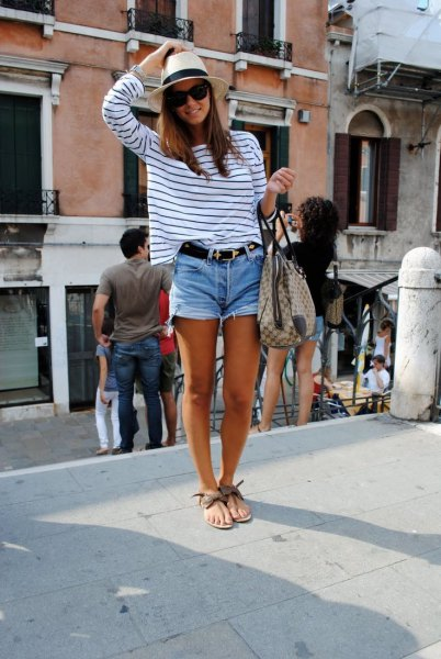 white and black striped long-sleeved T-shirt with cut off jeans shorts
