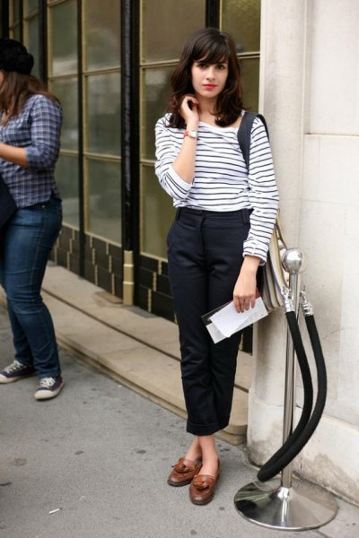 white and black striped long-sleeved T-shirt with black, short-cut chinos