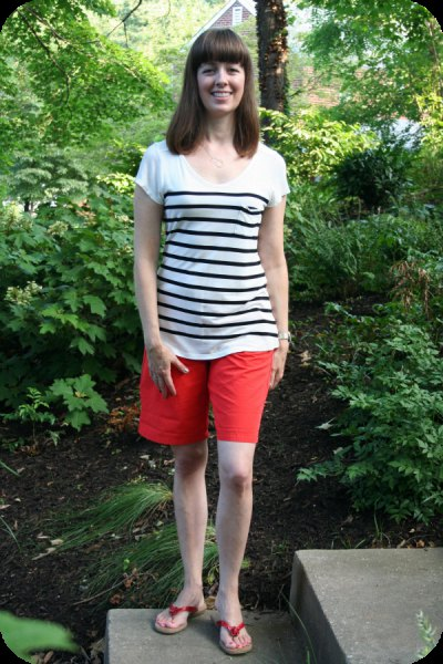 white and black striped t-shirt with scoop neckline, shorts and slide sandals