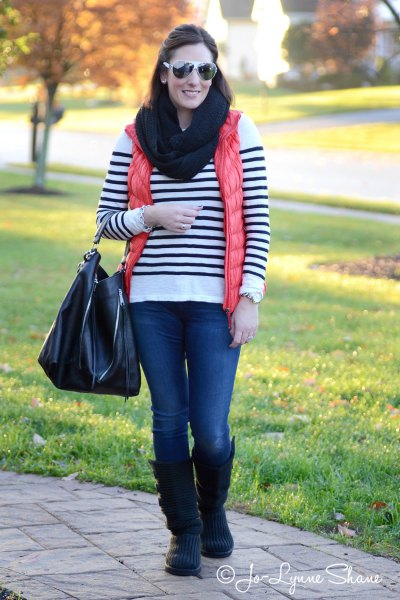 white and black striped sweater with knee-high boots made of suede