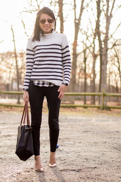 white and black sweater over plaid shirt