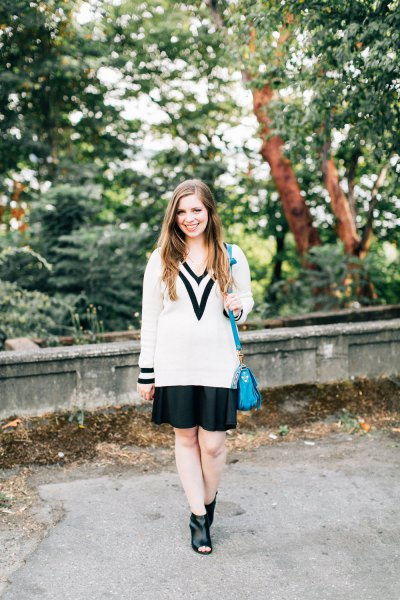 white and black sweater with black mini skirt and open toe boots