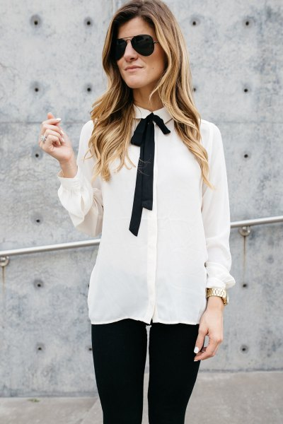 white and black chiffon shirt with tie neck and skinny jeans