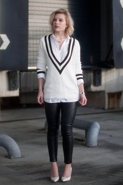 white and black V-neck sweater, shirt with buttons and leather gaiters