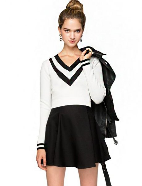 white and black sweater with V-neck and high-waisted minirater skirt