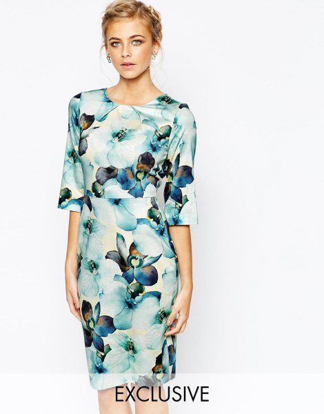 white and blue midi dress with wide sleeves and floral pattern