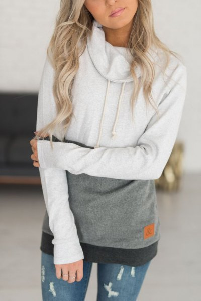 white and gray color block hoodie with ripped skinny jeans