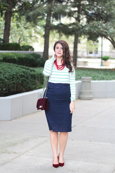 white-gray striped sweater with dark blue midi wrap skirt made of lace