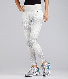 white and light gray patterned Nike running shorts with black t-shirt