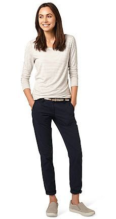 white and light gray striped long-sleeved top with slim fit jeans with black cuffs