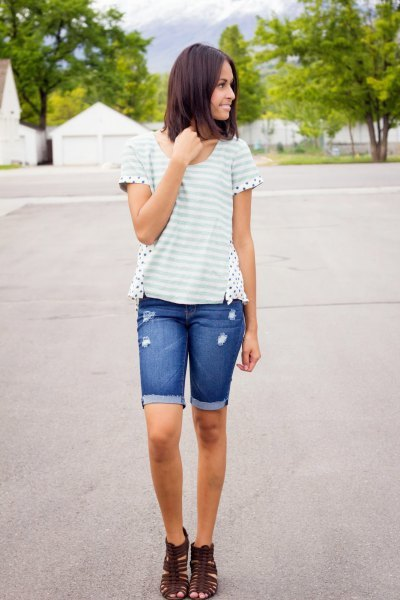 white and light gray striped t-shirt with long denim shorts with blue cuffs