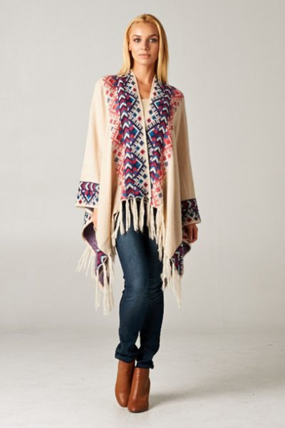 white and dark blue cardigan with fringes and brown leather ankle boots