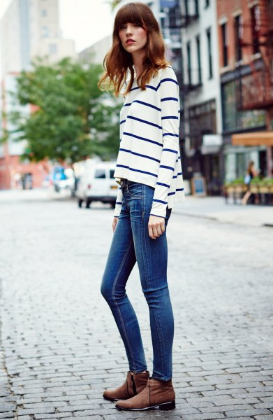 white and dark blue striped long-sleeved top skinny jeans